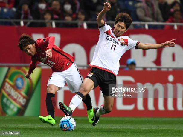 Yun Illok of FC Seoul and Takahiro Sekine of Urawa Red Diamonds compete for the ball during the AFC Champions League match Group F match between...
