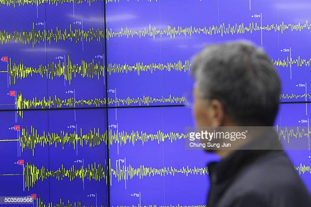 Yun WonTae a Earthquake and Volcano of the Korea Meteorological Administration Director General stands in front of a screen showing seismic waves...