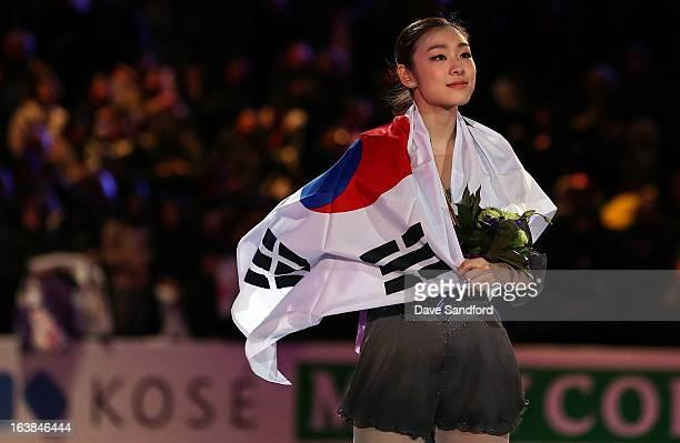 Yuna Kim of Korea celebrates her gold in the Ladies Free Skating Program during the 2013 ISU World Figure Skating Championships at Budweiser Gardens...