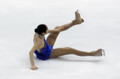 YuNa Kim of Korea falls during the Ladies Free Skate at the 2010 ISU World Figure Skating Championships on March 27 2010 at the Palevela in Turin...