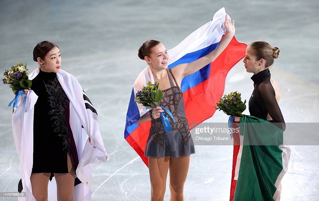 Yuna Kim (left to right) of South Korea, Adelina Sotnikova of Russia and Carolina Kostner of Italy celebrate after ladies' figure skating at the Iceberg Skating Palace during the Winter Olympics in Sochi, Russia, Thursday, Feb. 20, 2014.