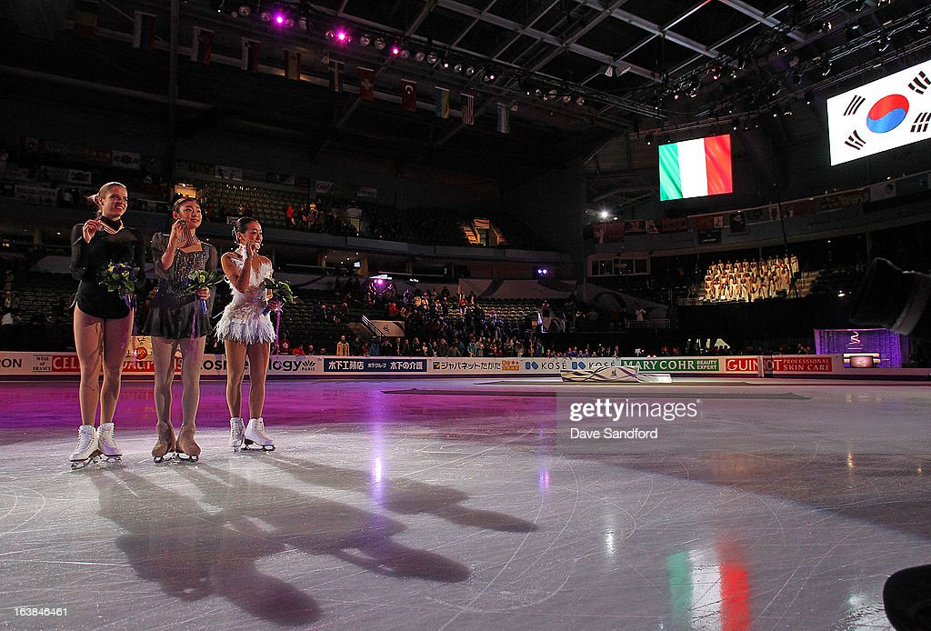 Yuna Kim of South Korea (C) celebrates winning the gold medal with Carolina Kostner of Italy (L) winning silver medal and Mao Asada of Japan winning the bronze medal in the Ladies Free Skating Program during the 2013 ISU World Figure Skating Championships at Budweiser Gardens on March 16, 2013 in London, Ontario, Canada.