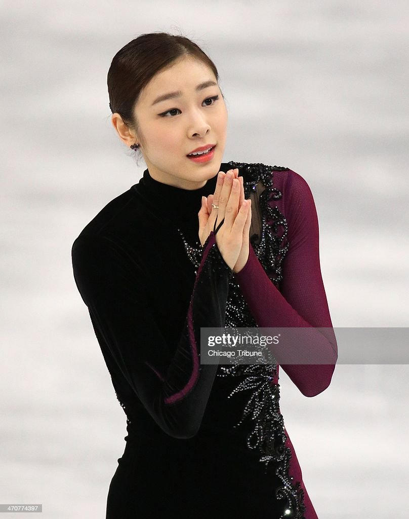 Yuna Kim of South Korea leaves the ice in the ladies' figure skating free skate at the Iceberg Skating Palace during the Winter Olympics in Sochi, Russia, Thursday, Feb. 20, 2014.