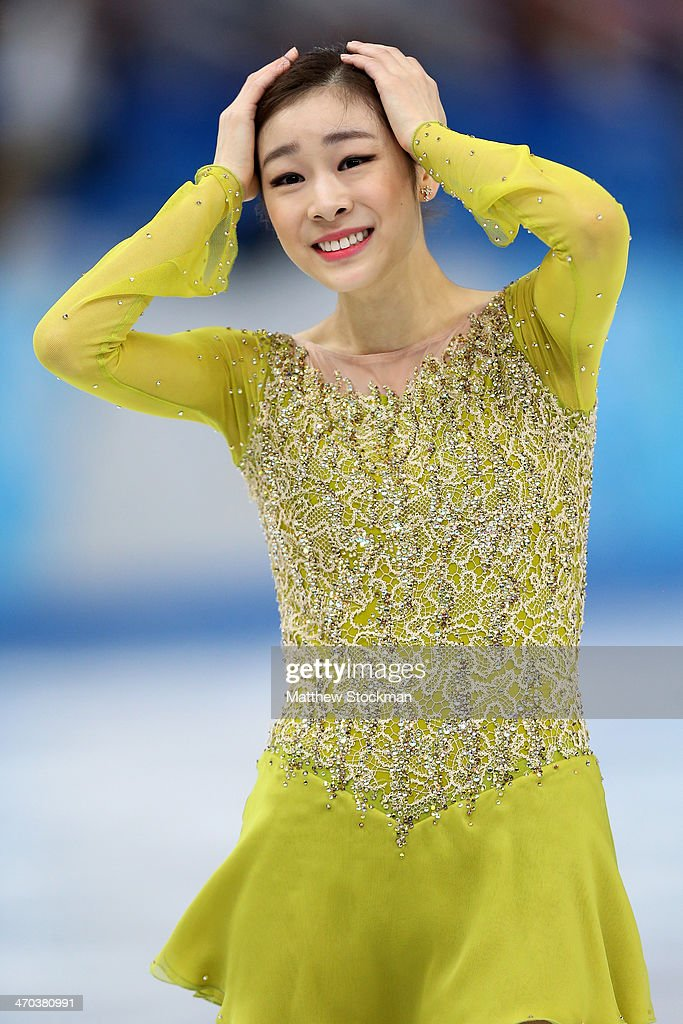 Yuna Kim of South Korea reacts after competing in the Figure Skating Ladies' Short Program on day 12 of the Sochi 2014 Winter Olympics at Iceberg...