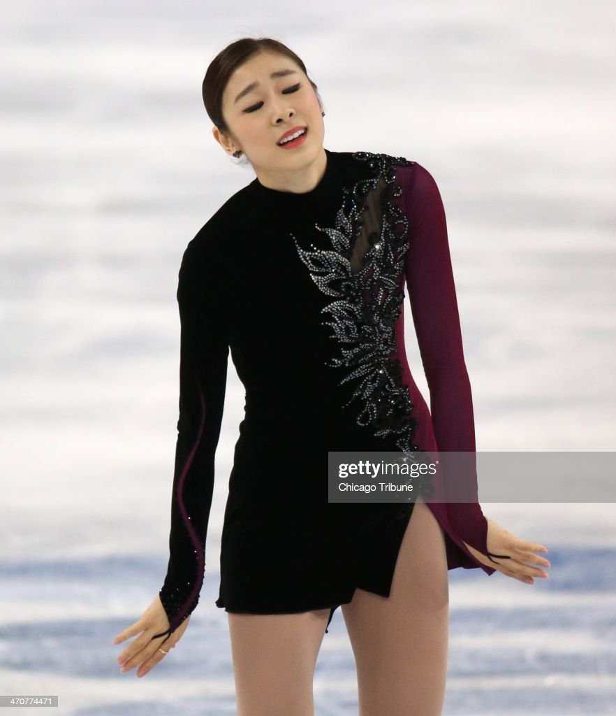 Yuna Kim of South Korea reacts after performing in the ladies' figure skating free skate at the Iceberg Skating Palace during the Winter Olympics in Sochi, Russia, Thursday, Feb. 20, 2014.