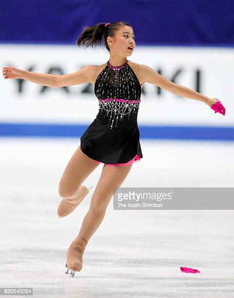 Yuna Shiraiwa drops her glove while competing in the Ladies' Singles Short Program during day three of the 85th All Japan Figure Skating...