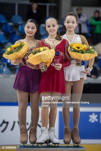 Yuna Shiraiwa of Japan Anastasiia Gubanova of Russia and Eunsoo Lim of Korea pose during the Junior Ladies Medal Ceremony on day three of the ISU...