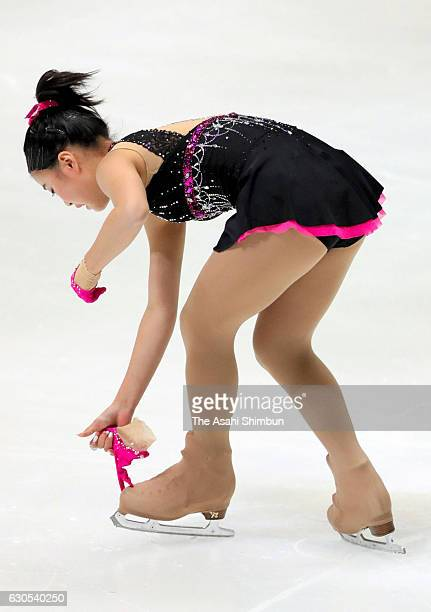 Yuna Shiraiwa picks up her glove while competing in the Ladies' Singles Short Program during day three of the 85th All Japan Figure Skating...
