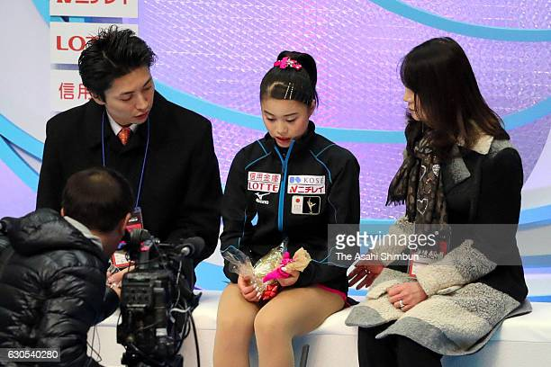 Yuna Shiraiwa reacts at the kiss and cry after competing in the Ladies' Singles Short Program during day three of the 85th All Japan Figure Skating...