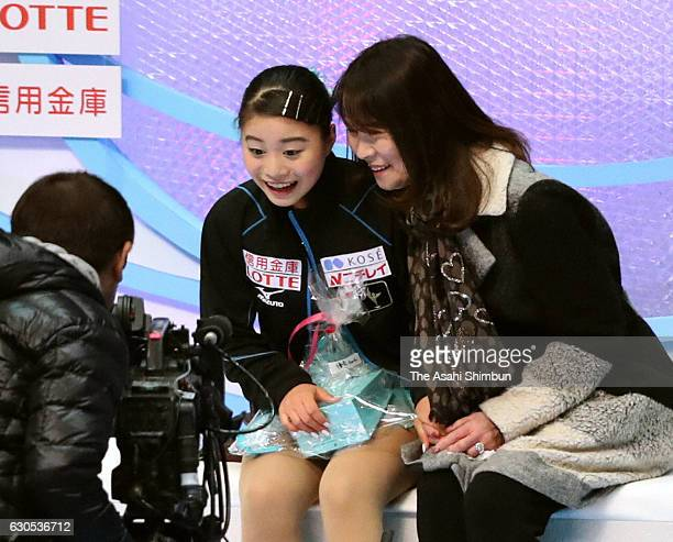 Yuna Shiraiwa waits for her score at the kiss and cry after competing in the Women's Singles Free Skating during day four of the 85th All Japan...