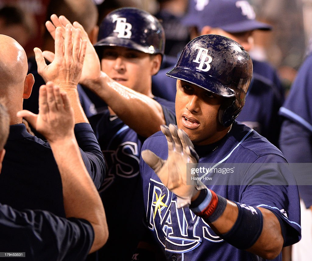 <a gi-track='captionPersonalityLinkClicked' href=/galleries/search?phrase=Yunel+Escobar&family=editorial&specificpeople=757358 ng-click='$event.stopPropagation()'>Yunel Escobar</a> #11 and Kelly Johnson #2 of the Tampa Bay Rays celebrate their runs off of a Ben Zobrist #18 double to take a 4-1 lead over the Los Angeles Angels during the fourth inning at Angel Stadium of Anaheim on September 3, 2013 in Anaheim, California.