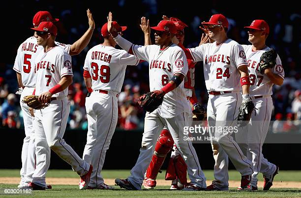 Yunel Escobar CJ Cron Cliff Pennington Andrew Bailey Rafael Ortega and Albert Pujols of the Los Angeles Angels of Anaheim celebrate after defeating...