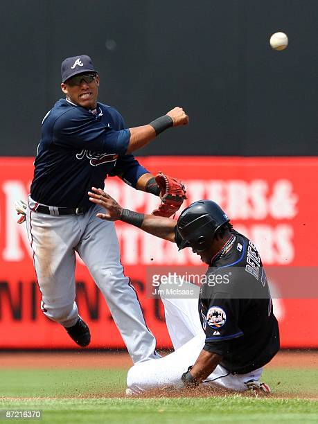 Yunel Escobar of the Atlanta Braves completes a double play in the third inning after forcing out Jose Reyes of the New York Mets on May 13 2009 at...