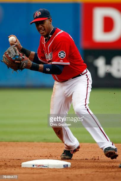 Yunel Escobar of the Atlanta Braves makes a throw to first against the New York Mets at Turner Field September 2 2007 in Atlanta Georgia The Mets...