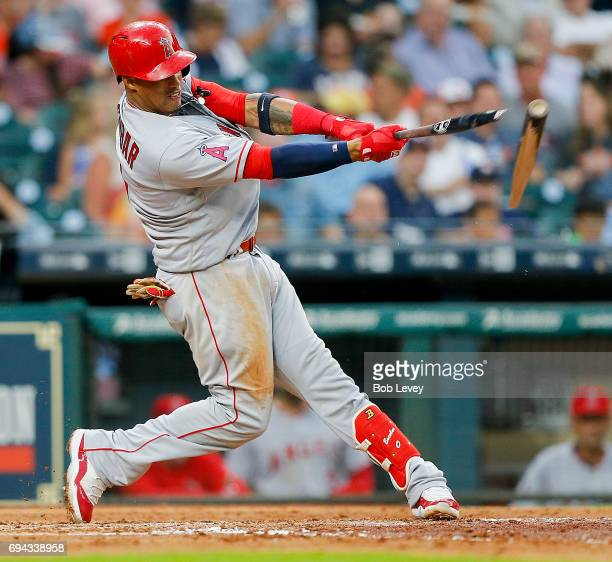 Yunel Escobar of the Los Angeles Angels of Anaheim breaks his bat as hr doubles in the third inning against the Houston Astros at Minute Maid Park on...