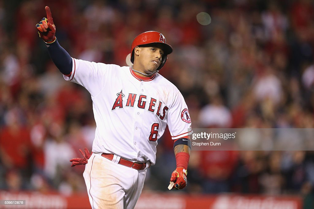 <a gi-track='captionPersonalityLinkClicked' href=/galleries/search?phrase=Yunel+Escobar&family=editorial&specificpeople=757358 ng-click='$event.stopPropagation()'>Yunel Escobar</a> #6 of the Los Angeles Angels of Anaheim celebrates as he runs to first after hitting a walk off RBI single in the ninth inning against the Cleveland Indians at Angel Stadium of Anaheim on June 11, 2016 in Anaheim, California.