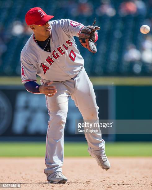Yunel Escobar of the Los Angeles Angels of Anaheim reaches for the baseball in the eighth inning during a MLB game against the Detroit Tigers at...