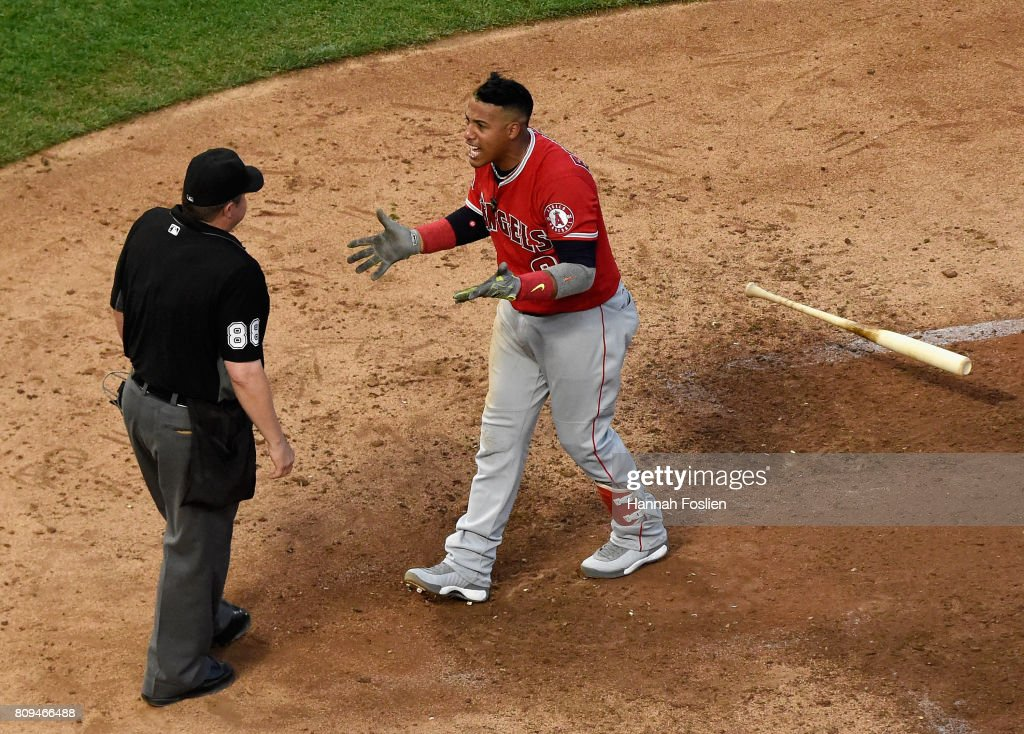 Yunel Escobar #0 of the Los Angeles Angels of Anaheim reacts to being ejected from the game by home plate umpire Doug Eddings #88 during the sixth inning of the game on July 5, 2017 at Target Field in Minneapolis, Minnesota.