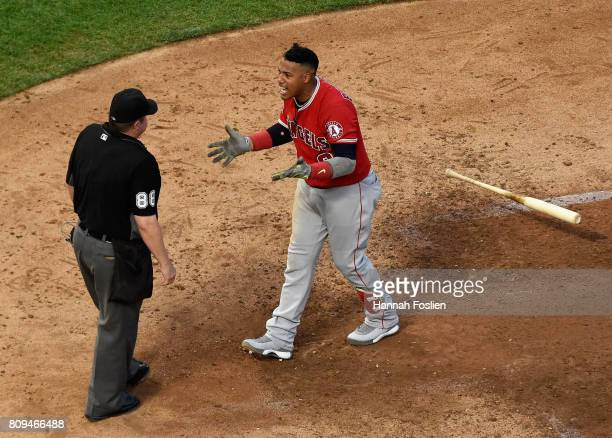 Yunel Escobar of the Los Angeles Angels of Anaheim reacts to being ejected from the game by home plate umpire Doug Eddings during the sixth inning of...