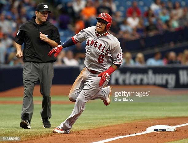 Yunel Escobar of the Los Angeles Angels of Anaheim rounds third base on his way to score off of an RBI single by Albert Pujols during the sixth...