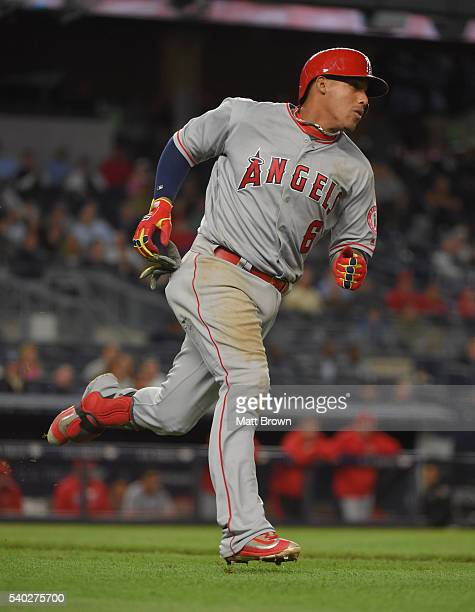 Yunel Escobar of the Los Angeles Angels of Anaheim runs after hitting a single during the eighth inning of the game against the New York Yankees at...