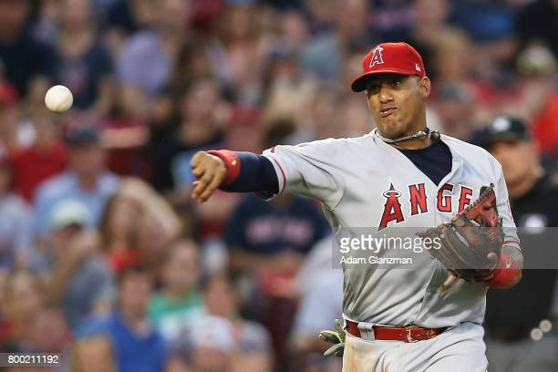 Yunel Escobar of the Los Angeles Angels of Anaheim throws to first base in the third inning of a game against the Boston Red Sox at Fenway Park on...