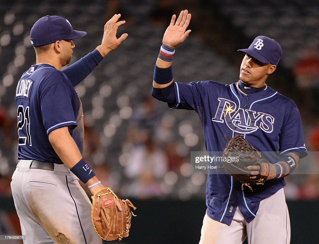 <a gi-track='captionPersonalityLinkClicked' href=/galleries/search?phrase=Yunel+Escobar&family=editorial&specificpeople=757358 ng-click='$event.stopPropagation()'>Yunel Escobar</a> #11 of the Tampa Bay Rays celebrates a 7-1 win over the Los Angeles Angels with <a gi-track='captionPersonalityLinkClicked' href=/galleries/search?phrase=James+Loney&family=editorial&specificpeople=636293 ng-click='$event.stopPropagation()'>James Loney</a> #21 at Angel Stadium of Anaheim on September 3, 2013 in Anaheim, California.