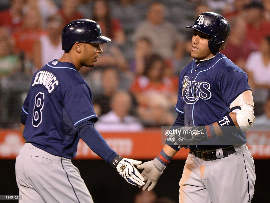 <a gi-track='captionPersonalityLinkClicked' href=/galleries/search?phrase=Yunel+Escobar&family=editorial&specificpeople=757358 ng-click='$event.stopPropagation()'>Yunel Escobar</a> #11 of the Tampa Bay Rays celebrates his solo homerun with <a gi-track='captionPersonalityLinkClicked' href=/galleries/search?phrase=Desmond+Jennings&family=editorial&specificpeople=5974085 ng-click='$event.stopPropagation()'>Desmond Jennings</a> #8 for a 6-1 lead over the Los Angeles Angels during the sixth inning at Angel Stadium of Anaheim on September 3, 2013 in Anaheim, California.