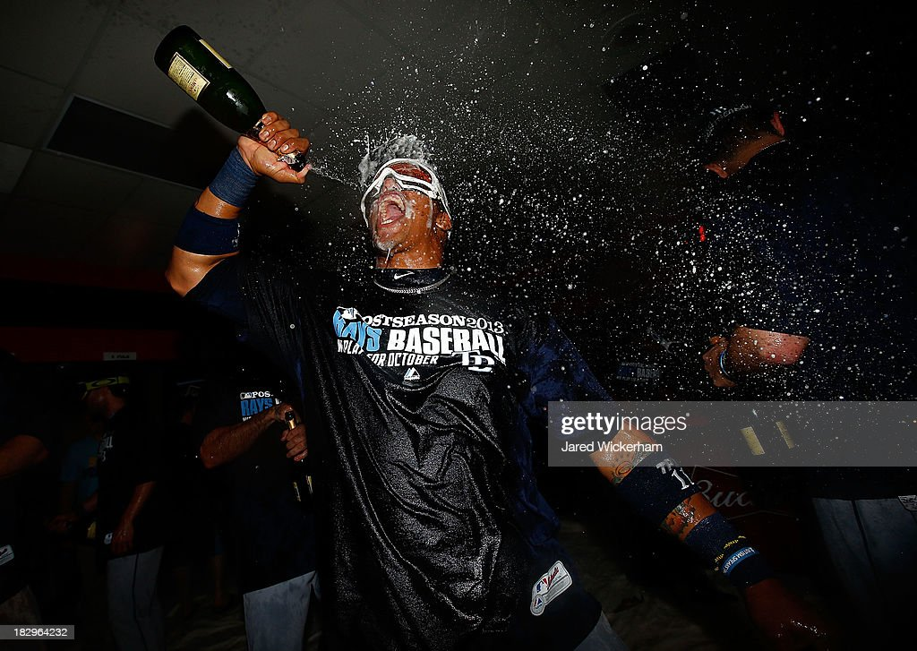Yunel Escobar #11 of the Tampa Bay Rays celebrates in the clubhouse following their 4-0 win against the Cleveland Indians during the American League Wild Card game at Progressive Field on October 3, 2013 in Cleveland, Ohio.