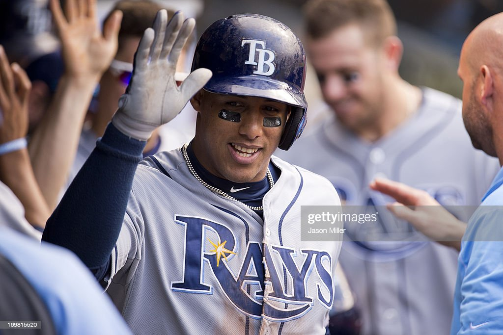 <a gi-track='captionPersonalityLinkClicked' href=/galleries/search?phrase=Yunel+Escobar&family=editorial&specificpeople=757358 ng-click='$event.stopPropagation()'>Yunel Escobar</a> #11 of the Tampa Bay Rays celebrates in the dugout after hitting a two run home run during the sixth inning against the Cleveland Indians at Progressive Field on June 2, 2013 in Cleveland, Ohio.
