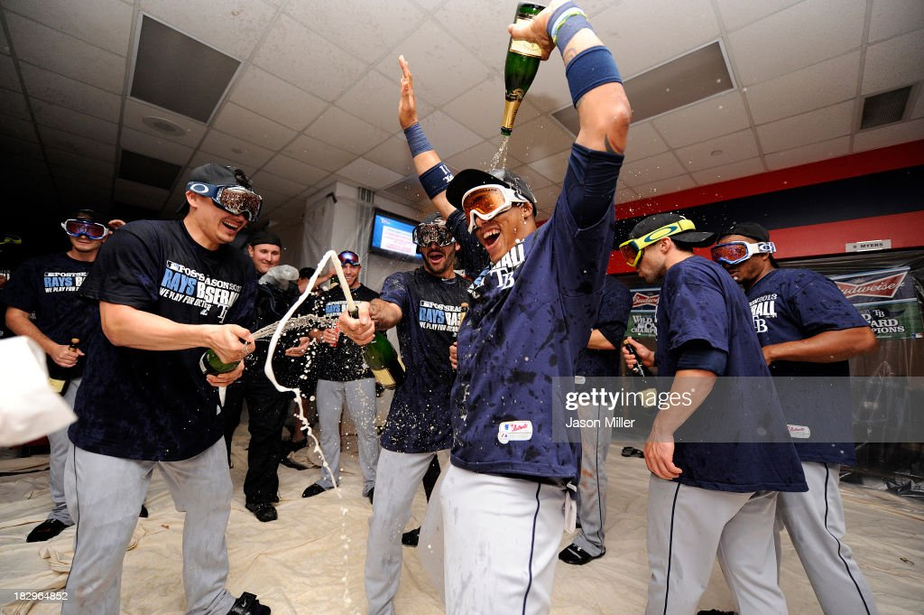 Yunel Escobar #11 of the Tampa Bay Rays celebrates with teammates in the clubhouse after defeating the Cleveland Indians 4-0 at Progressive Field on October 2, 2013 in Cleveland, Ohio.