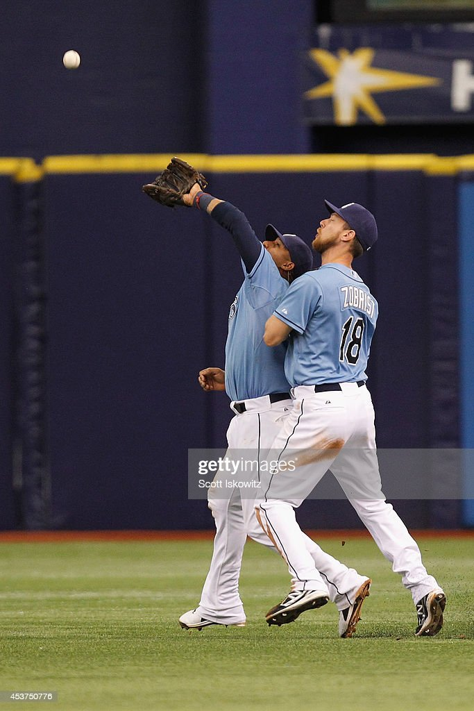 Yunel Escobar #11 of the Tampa Bay Rays collides into teammate Ben Zobrist #18 of the Tampa Bay Rays and drops the ball during the eighth inning against the New York Yankees at Tropicana Field on August 17, 2014 in St Petersburg, Florida.