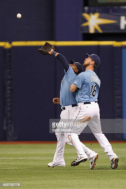 Yunel Escobar of the Tampa Bay Rays collides into teammate Ben Zobrist of the Tampa Bay Rays and drops the ball during the eighth inning against the...