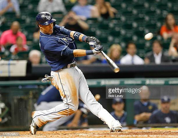 Yunel Escobar of the Tampa Bay Rays doubles in the ninth inning scoring two runs against the Houston Astros at Minute Maid Park on July 2 2013 in...