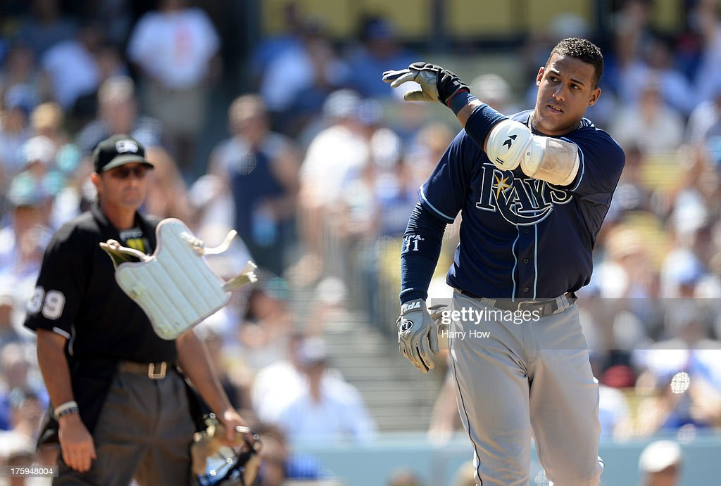 <a gi-track='captionPersonalityLinkClicked' href=/galleries/search?phrase=Yunel+Escobar&family=editorial&specificpeople=757358 ng-click='$event.stopPropagation()'>Yunel Escobar</a> #11 of the Tampa Bay Rays reacts to his strikeout in front of home plate umpire Paul Nauert to end the sixth inning against the Los Angeles Dodgers at Dodger Stadium on August 10, 2013 in Los Angeles, California.