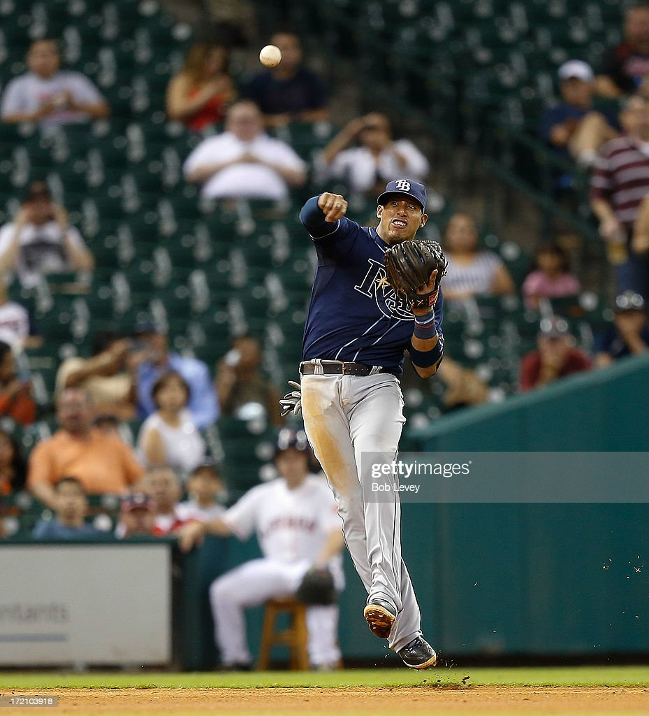 Yunel Escobar #11 of the Tampa Bay Rays throws from deep shortstop to retire Brandon Barnes #2 of the Houston Astros in the fifth inning at Minute Maid Park on July 1, 2013 in Houston, Texas.