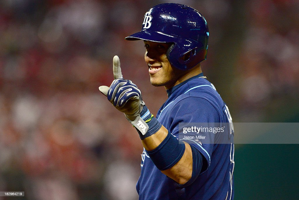 Yunel Escobar #11 of the Tampa Bay Rays waves his finger at his teammates from first base during the ninth inning against the Cleveland Indians Progressive Field on October 2, 2013 in Cleveland, Ohio.