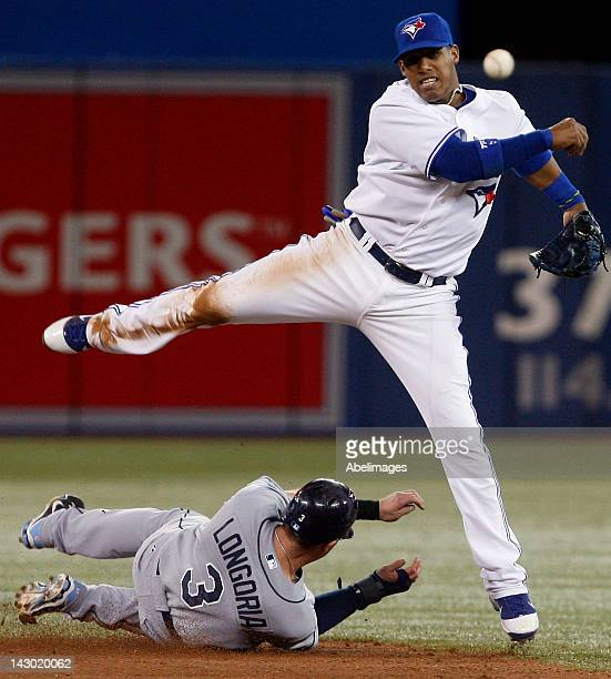 Yunel Escobar of the Toronto Blue Jays makes the double play on Evan Longoria of the Tampa Bay Rays during MLB action at the Rogers Centre April 17...