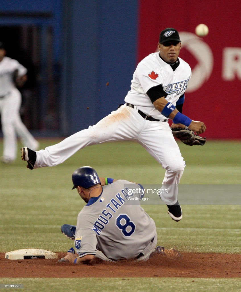 <a gi-track='captionPersonalityLinkClicked' href=/galleries/search?phrase=Yunel+Escobar&family=editorial&specificpeople=757358 ng-click='$event.stopPropagation()'>Yunel Escobar</a> #5 of the Toronto Blue Jays makes the double play on <a gi-track='captionPersonalityLinkClicked' href=/galleries/search?phrase=Mike+Moustakas&family=editorial&specificpeople=6780077 ng-click='$event.stopPropagation()'>Mike Moustakas</a> #8 of the Kansas City Royals during MLB action at Rogers Centre August 24, 2011 in Toronto, Ontario, Canada.