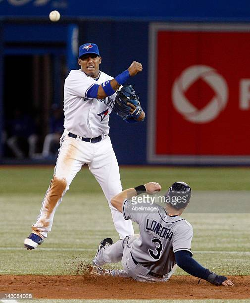 Yunel Escobar of the Toronto Blue Jays makes the double play over Evan Longoria of the Tampa Bay Rays during MLB action at the Rogers Centre April 18...
