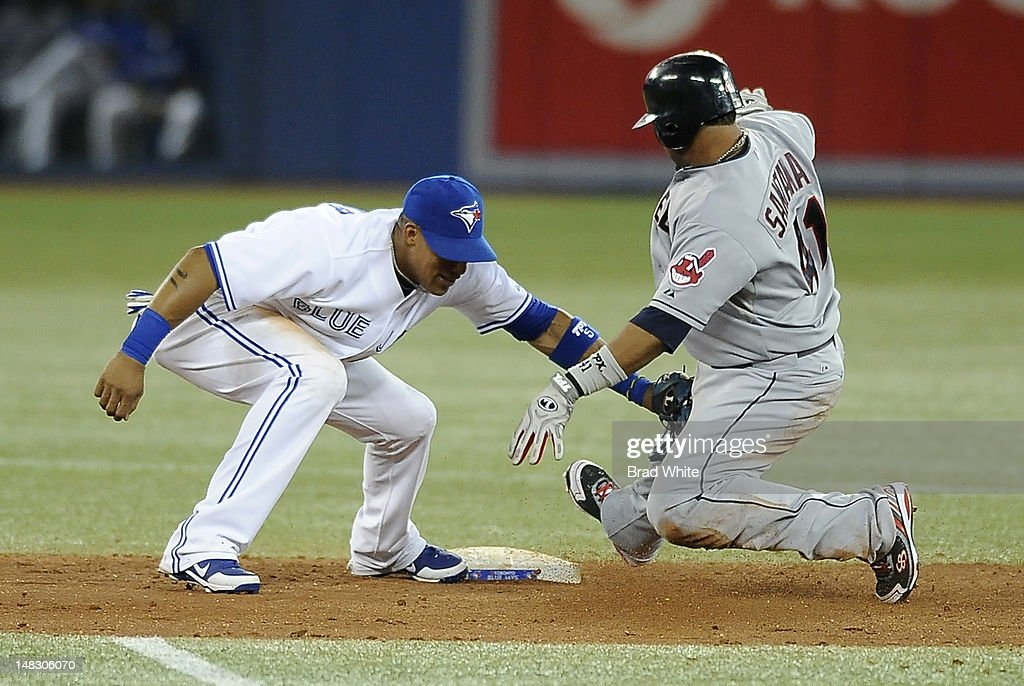 <a gi-track='captionPersonalityLinkClicked' href=/galleries/search?phrase=Yunel+Escobar&family=editorial&specificpeople=757358 ng-click='$event.stopPropagation()'>Yunel Escobar</a> #5 of the Toronto Blue Jays tags out Carlos Santana #41 of the Cleveland Indians at second base on an attempted steal during MLB game action July 13, 2012 at Rogers Centre in Toronto, Ontario, Canada.