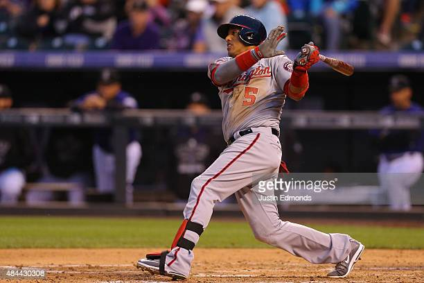 Yunel Escobar of the Washington Nationals watches his RBI single during the third inning against the Colorado Rockies at Coors Field on August 18...
