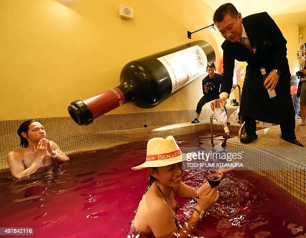 Yunessan sommelier Yasunari Kuwajima pours 2015 Beaujolais Nouveau wine at the wine spa in the Hakone Yunessun spa resort facilities in Hakone town...
