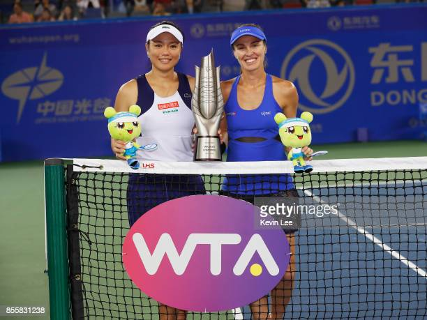 Yung Jan Chan of Chinese Taipei and Martina Hingis of Switzerland celebrate with the trophy following their victory during the Ladies Doubles final...