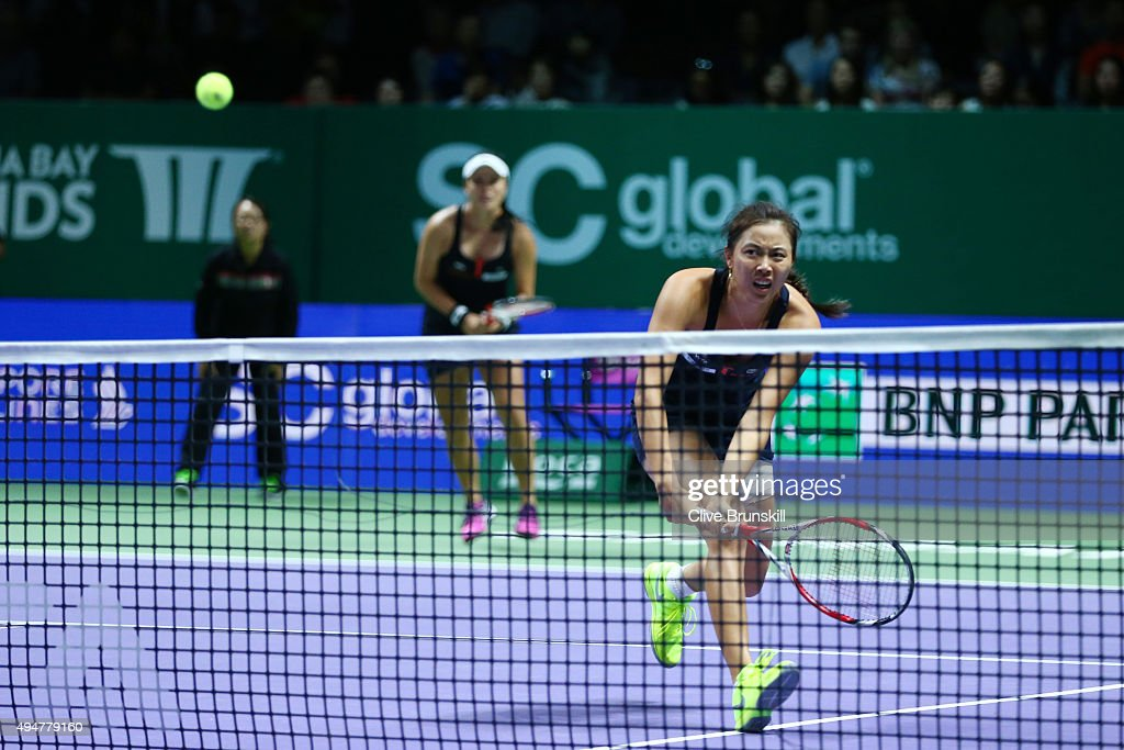 YungJan Chan and HaoChing Chan of Chinese Taipei in action against Carla Suarez Navarro and Garbine Muguruza of Spain in a doubles round robin match...