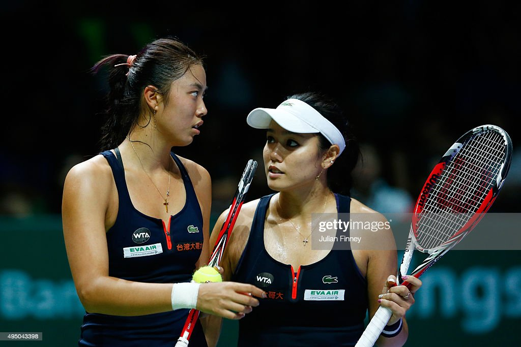 YungJan Chan and HaoChing Chan of Chinese Taipei in action durig their doubles semifinal match against Sania Mirza of India and Martina Hingis of...