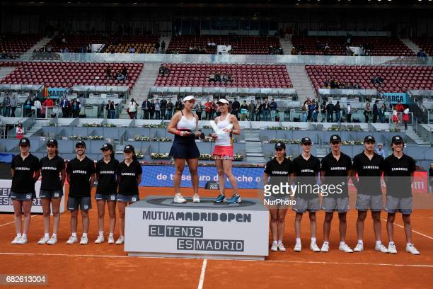 YungJan Chan and Martina Hingis win the women's doubles final of the Mutua Madrid Open tennis at La Caja Magica on May 13 2017 in Madrid Spain