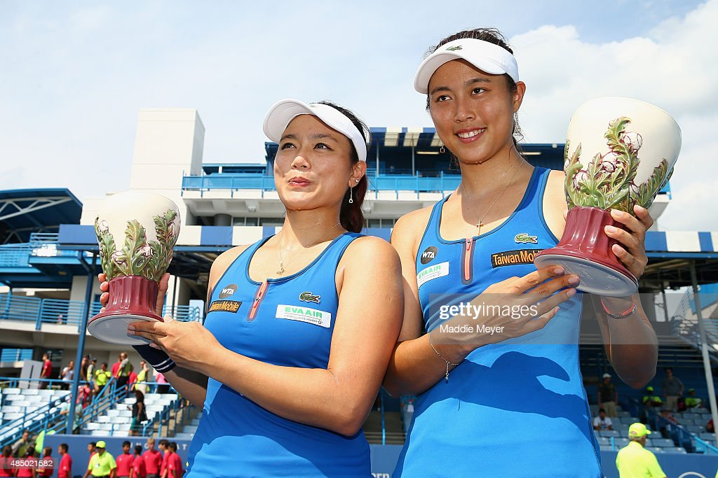 YungJan Chan left and HaoChing Chan of Taipei celebrate after winning the Women's Doubles Championship Final against Casey Dellacqua of Australia and...
