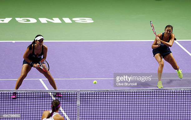 YungJan Chan of Chinese Taipei and HaoChing Chan of Chinese Taipei in action against Caroline Garcia of France and Katarina Srebotnik of Slovenia in...