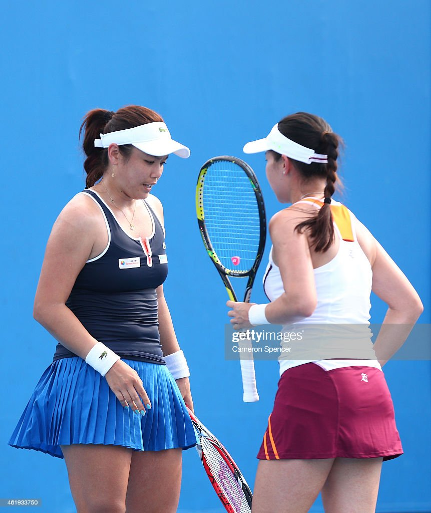 YungJan Chan of Chinese Taipei and Jie Zheng of China talk tactics in their first round doubles match against Klara Koukalova of the Czech Republic...